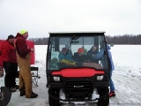 K&E Tackle Bum Lake ice fishing get together 02062011-076 kids eating in buggie