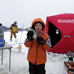 A happy young ice angler with a big crappie caught during the K&E Tackle ice fishing get together