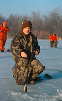 Young Angler With Panfish caught while ice fishing