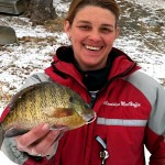 The other half of team Hard Water Maniacs, Mandy MacHaffie shows off a big bull bluegill caught through the ice