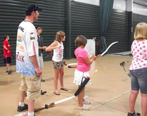 Ray Tiffany works with youth at free Hard Water Maniacs archery courses