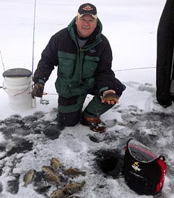 Local ice fishing guru and Team Stopper pro staff member Bill Ferris shows a nice mess of ice fishing panfish.