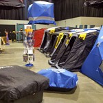 Ice fishing shanties and shelters are lined up, even floating in the air for the 2013 Ultimate Fishing Show Detroit ice extravaganza.