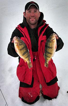 Josh Clawson with two North Dakota jumbo ice fishing caught yellow perch