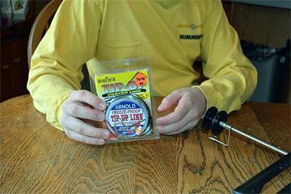 Tip up setup rigging step 2 - tying on your Arnold freeze proof line