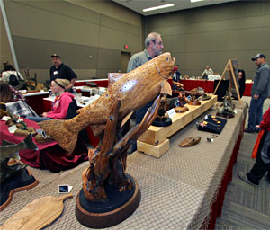 Taxidermy and wood carvings like this beautiful carved trout are just some of the family friendly attractions at the 2014 Ultimate Sport Show Grand Rapids