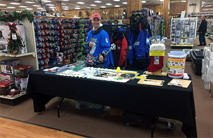 Joe Devera mans the table during Jay's Ice Day when he's not doing his ice fishing seminar