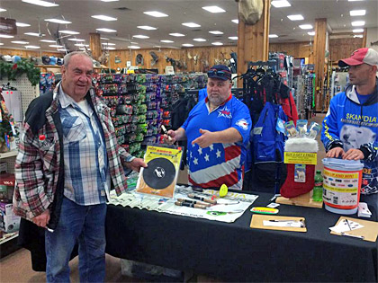 A customer checks out the K & E Tackle Auger Adapter while visiting the ice fishing table at Jay's Ice Day