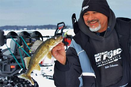 Mark Martin Pro-staff Mike Schneider shows a typical Houghton Lake walleye