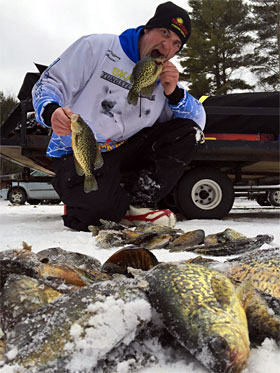 Ray Tiffany shows off a mess of metallic caught panfish