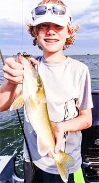 Cody Caraway with a Yukon Minnow caught South Dakota walleye