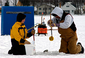 Ice anglers checking a tip-up to see what they caught