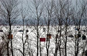 Ice fishing shanties and shacks on thick winter ice